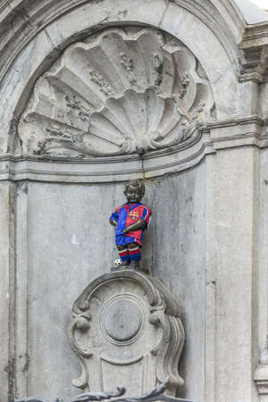 literally: Manneken Pis(literally Little Man Pee in Marols, a Dutch dialect spoken in Brussels, also known in French as le Petit Julien), the a famous Brussels landmark in Belgium. Editorial