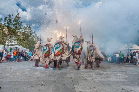 cercavila: VILAFRANCA DEL PENEDES, SPAIN - AUG 29: Ball de Diables dance on Cercavila performance within the Festa Major celebrations Aug 29, 2012 in Vilafranca del Penedes, Spain.