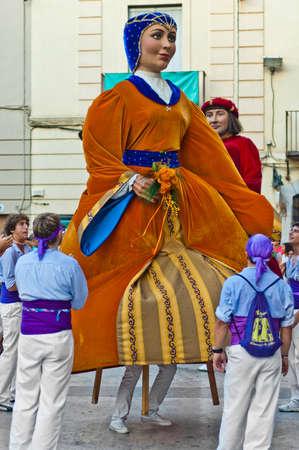 festividad: VILANOVA I LA GELTRU, SPAIN - AUG 04: Gegants parade at Cercavila performance within the Festa Major celebrations Aug 04, 2011 in Vilanova i la Geltru, Spain.