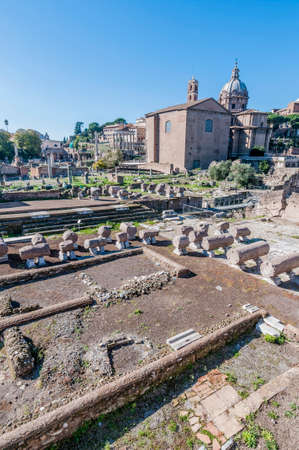 The Roman Forum (Foro Romano) a rectangular forum (plaza) surrounded by the ruins of several important ancient government buildings at the center of the city of Rome in Italy. Stock Photo - 26031589