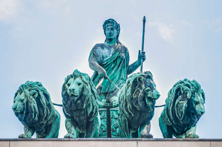 The Victory Gate (Siegestor), a three-arched triumphal arch crowned with a statue of Bavaria with a lion-quadriga in Munich, Germany