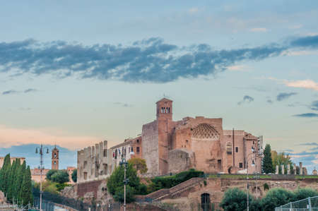 The Roman Forum (Foro Romano) a rectangular forum (plaza) surrounded by the ruins of several important ancient government buildings at the center of the city of Rome in Italy. photo