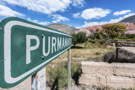 siete: Sign near Cerro de los Siete Colores (The Hill of Seven Colors) behind Purmamarca village, in the colourful valley of Quebrada de Humahuaca in Jujuy Province, northern Argentina. Stock Photo