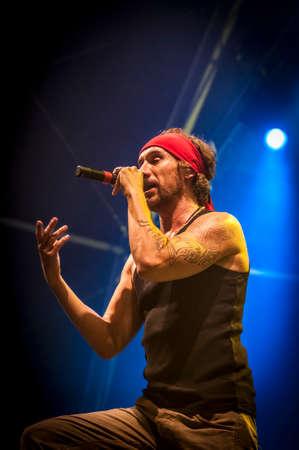 merce: BARCELONA - SEP 22: Spanish singer Macaco performs at the Hard Rock Rocks La Merce concert within La Merce celebrations on September 22, 2012 in Barcelona, Spain