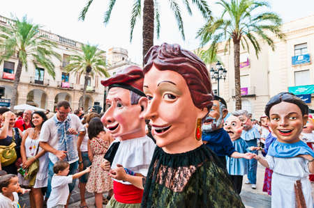 fireruns: VILANOVA I LA GELTRU, SPAIN - AUG 04: Capgrossos parade at the Cercavila performance within the Festa Major celebrations Aug 04, 2011 in Vilanova i la Geltru, Spain. Editorial