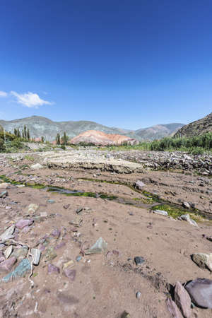 siete: Cerro de los Siete Colores (The Hill of Seven Colors) behind Purmamarca village, in northern Argentina. Stock Photo