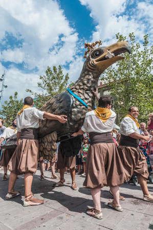 patron of europe: VILAFRANCA DEL PENEDES, SPAIN - AUG 29: Aliga fantastic figure on Cercavila performance within the Festa Major celebrations Aug 29, 2012 in Vilafranca del Penedes, Spain.