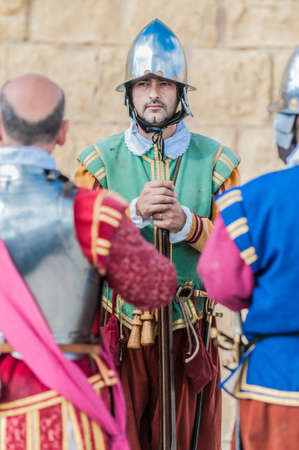 garrison: BIRGU - NOV 04: In Guardia re-enactment portraying the inspection of the fort and its garrison by the Grand Bailiff of the Order of the Knights of St. John on November 04, 2012 in Birgu, Malta.