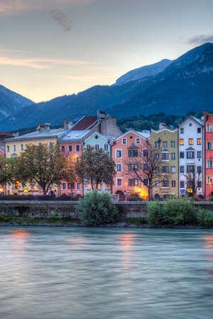 tributary: INNSBRUCK, AUSTRIA - AUG 15: Inn river, a 517 kilometres long tributary of the Danube on its way through the capital of Tyrol region on Aug 15, 2013 in Innsbruck, Austria.