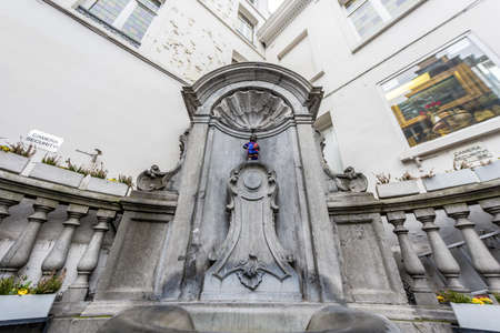 Manneken Pis (literally Little Man Pee in Marols, a Dutch dialect spoken in Brussels, also known in French as le Petit Julien), the a famous Brussels landmark in Belgium.