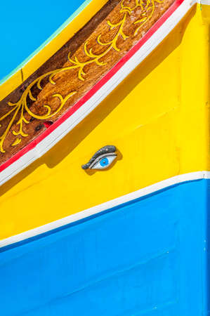 eye of horus: Eye of Horus or Osiris in traditional Luzzu boat at Marsaxlokk harbor, a fishing village located in the south-eastern part of Malta.