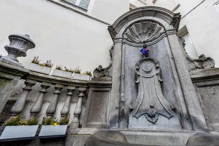 literally: Manneken Pis (literally Little Man Pee in Marols, a Dutch dialect spoken in Brussels, also known in French as le Petit Julien), the a famous Brussels landmark in Belgium.