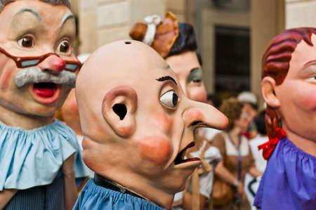 cercavila: VILANOVA I LA GELTRU, SPAIN - AUG 04: Capgrossos parade at the Cercavila performance within the Festa Major celebrations Aug 04, 2011 in Vilanova i la Geltru, Spain. Editorial