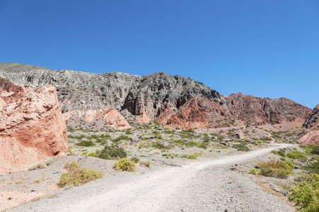 colores: Los Colorados path in Purmamarca, near Cerro de los Siete Colores (The Hill of Seven Colors), in the colourful valley of Quebrada de Humahuaca in Jujuy Province, northern Argentina.