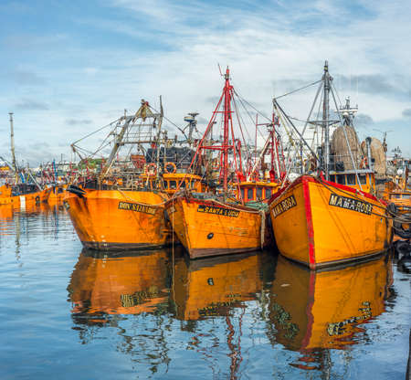 Typical orange fishing boats on the port of the coastal city of Mar del Plata in Buenos Aires province, Argentina Editorial