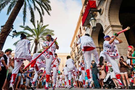 cercavila: VILANOVA I LA GELTRU, SPAIN - AUG 04: Balls the Bastons dancers at the Cercavila performance within the Festa Major celebrations Aug 04, 2011 in Vilanova i la Geltru, Spain. Editorial