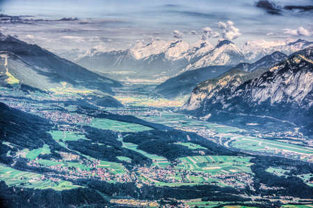 Inn river valley as seen from mountain and ski area of Patscherkofel in Tyrol region, south of Innsbruck in western Austria. Stock Photo