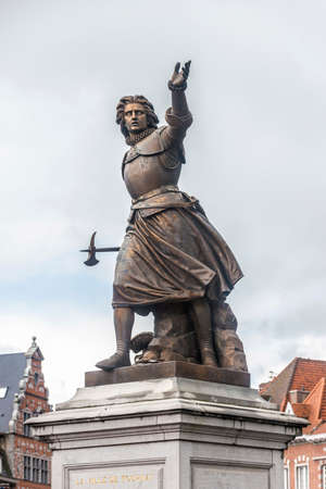honoring: Monument on Grand Place honoring Marie-Christine de Lalaing, who defended Tournai against the Duke of Parma, Alessandro Farnese in 1581 in Tournai, Belgium.