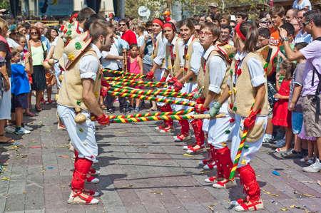 cercavila: VILAFRANCA DEL PENEDES, SPAIN - AUG 29: Pastorets dancers on Cercavila performance within the Festa Major celebrations Aug 29, 2011 in Vilafranca del Penedes, Spain. Editorial