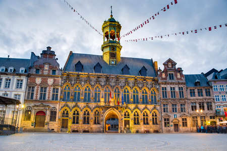 walloon: Gothic style City Hall and its renaissance bell tower on the central square in Mons, capital of the Wallonian province of Hainaut in Belgium.