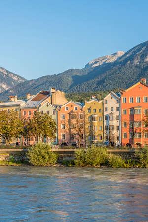 kilometres: Inn river, a 517 kilometres long tributary of the Danube on its way through the capital of Tyrol region on Aug 16, 2013 in Innsbruck, Austria. Stock Photo