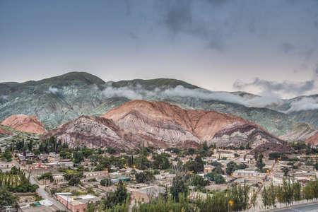 colores: Cerro de los Siete Colores (The Hill of Seven Colors) behind Purmamarca village, in the colourful valley of Quebrada de Humahuaca in Jujuy Province, northern Argentina.
