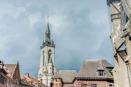 The oldest belfry in Belgium, a freestanding bell tower of medieval origin, 72 metres in height with a 256-step stairway in Tournai. Stock Photo