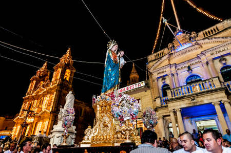 devout: GUDJA - OCT 28: Virgin Santa Marija Assunta night devout procession on October 28, 2012 in Gudja, Malta.