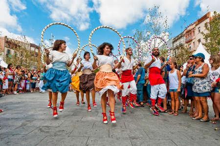 cercavila: VILAFRANCA DEL PENEDES, SPAIN - AUG 29: Cercolets dancers on Cercavila performance within the Festa Major celebrations Aug 29, 2011 in Vilafranca del Penedes, Spain.