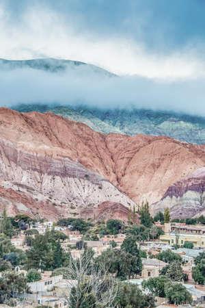 siete: Cerro de los Siete Colores (The Hill of Seven Colors) behind Purmamarca village, in the colourful valley of Quebrada de Humahuaca in Jujuy Province, northern Argentina.