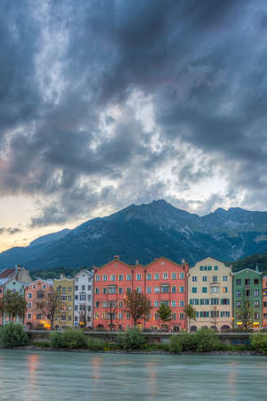 places of interest: INNSBRUCK, AUSTRIA - AUG 16: Colorful houses of Mariahilf Street along Inn river on Aug 16, 2013 in Innsbruck, Austria.