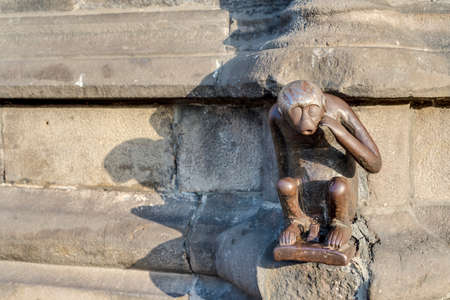 cityhall: Guardhouse Monkey small iron statue outside the main entrance of the City Hall in Mons, capital of the Wallonian province of Hainaut in Belgium.