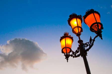dominant color: One of the many streetlamps located at es Born Square, Ciutadella, Minorca Island. Stock Photo