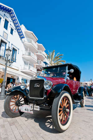 motorcar: SITGES, SPAIN - MARCH 11: Jordi Buil drives a 1924 Ford T on the second phase of the 54th Rally of Ancient Cars Barcelona-Sitges on March 11, 2012 in Sitges, Spain.
