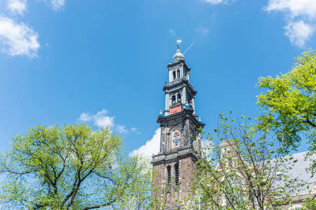 westerkerk: Westerkerk (Western church) next to Jordaan district, on the bank of the Prinsengracht canal in Amsterdam, Netherlands. Stock Photo