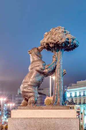 represents: Statue of the Bear and the Strawberry Tree (Oso y el Madrono), sculpture which represents the heraldic arms of the city, installed on Puerta del Sol Square in Madrid, Spain. Editorial