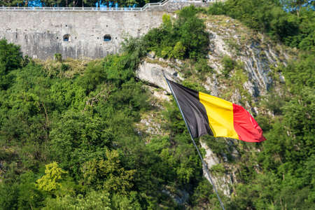 walloon: Flag waving in the city of Dinant, Belgium Stock Photo