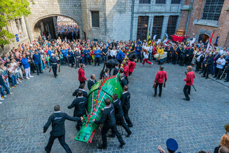 intangible: MONS, BELGIUM - JUNE 14, 2014: Waltrude's Shrine Procession within The Ducasse de Mons (Doudou) celebrations, recognized as one of the Masterpieces of the Oral and Intangible Heritage of Humanity. Editorial