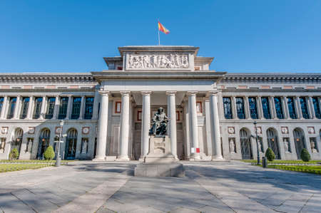 Prado Museum facade and Cervantes statue in Madrid, Spain Editorial