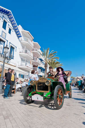 motorcar: SITGES, SPAIN - MARCH 11: Salvador Berenguer drives a 1905 DARRACQ on the second phase of the 54th Rally of Ancient Cars Barcelona-Sitges on March 11, 2012 in Sitges, Spain.