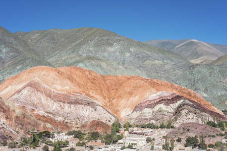 siete: Cerro de los Siete Colores (The Hill of Seven Colors) behind Purmamarca village, in the colourful valley of Quebrada de Humahuaca in Jujuy Province, northern Argentina.