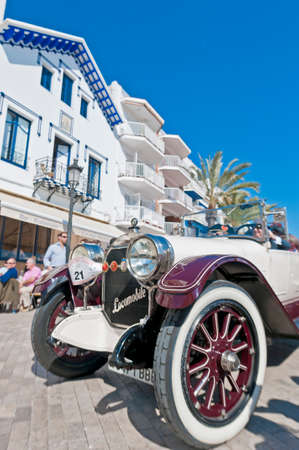 motorcar: SITGES, SPAIN - MARCH 11: Alfredo Fuster Del Solo drives a 1918 LOCOMOBILE on the second phase of the 54th Rally of Ancient Cars Barcelona-Sitges on March 11, 2012 in Sitges, Spain.