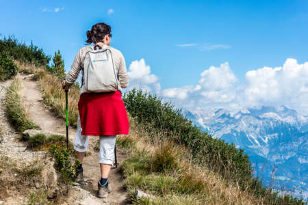 Hiker at mountain and ski area of Patscherkofel in Tyrol region, south of Innsbruck in western Austria. Editorial