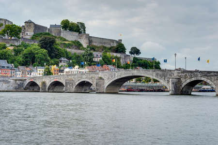 meuse: Jambes Bridge crossing the river Meuse as it passes through the city of Namur in the Wallonia Region, southern Belgium Stock Photo