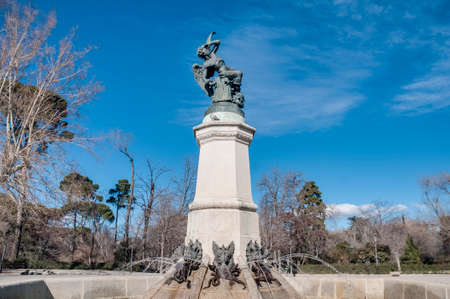 fallen angel: The Fountain of the Fallen Angel (Fuente del Angel Caido) or Monument of the Fallen Angel, a highlight of the Buen Retiro Park in Madrid, Spain. Stock Photo