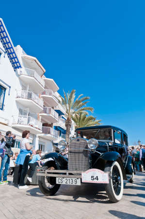 motorcar: SITGES, SPAIN - MARCH 11: Antoni Collado drives a 1928 Ford A on the second phase of the 54th Rally of Ancient Cars Barcelona-Sitges on March 11, 2012 in Sitges, Spain. Editorial
