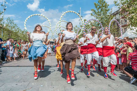 patron of europe: VILAFRANCA DEL PENEDES, SPAIN - AUG 29: Ball de Cercolets dance on Cercavila performance within the Festa Major celebrations Aug 29, 2012 in Vilafranca del Penedes, Spain.
