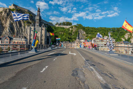 walloon: DINANT, BELGIUM – JUNE 15, 2014: The bridge crosses the river Meuse passing through the town of Dinant, located in the Walloon region of southern Belgium.