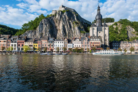 walloon: DINANT, BELGIUM – JUNE 15, 2014: The Meuse River passing through the town of Dinant, located in the Walloon, Belgium.