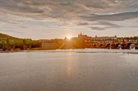 to seem: Sunset on Vltava river as seem from Rasinovo Street